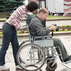 Bigstockphoto Man In A Wheelchair With Camer 5372993 Promo
